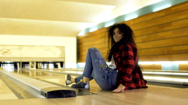 Pretty woman throws bowling ball and falls down on the path video