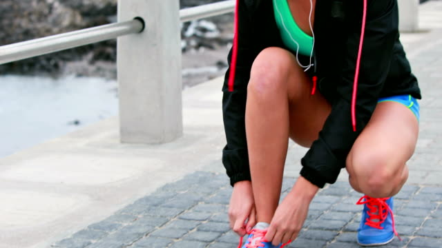 Pretty young determined woman running video