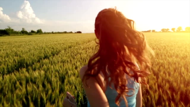 Pretty Young Female Model Running Through Wheat Field video