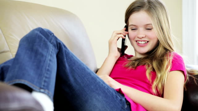 Pretty young girl talking on mobile phone video