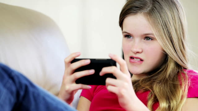 Pretty young teenage girl sending text message video
