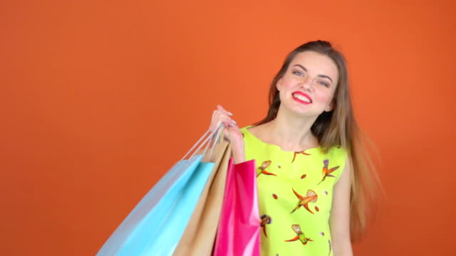 Pretty young woman standing keeps shoulders shopping bags Pretty young woman standing keeps shoulders shopping bags human joint stock videos & royalty-free footage