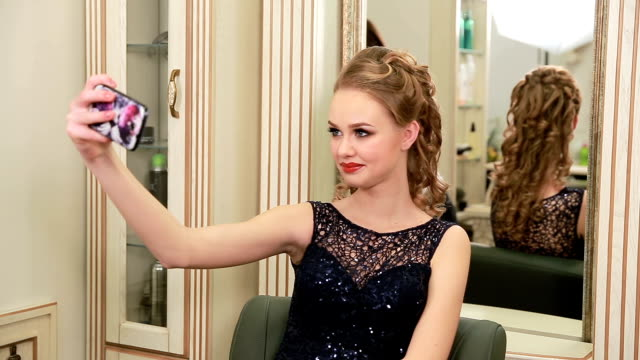 pretty young woman with beautiful make-up and elegant hairstyle in evening dress takes selfie - prom fashion stock videos and b-roll footage