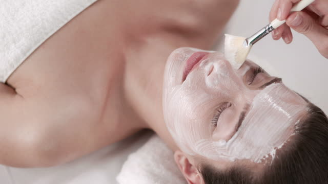 hd: pretty young woman with facial mask - face mask stock videos & royalty-free footage