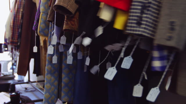 Price Tags Swinging on Coats in Vintage Fashion Store video