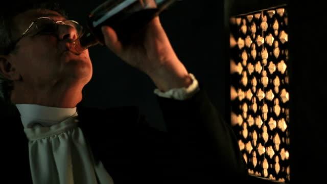 Priest drinking alchohol/wine in confession video