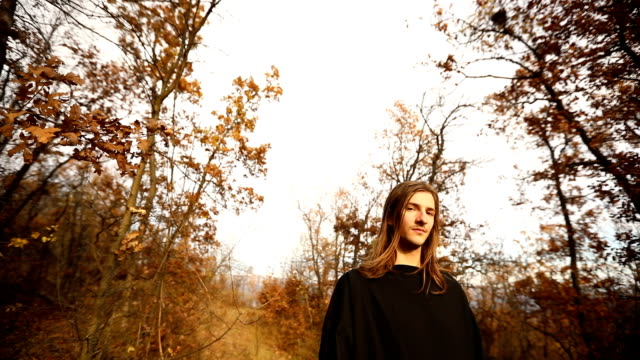 Priest in forest Priests in black clothing standing in forest on autumn day. long hair stock videos & royalty-free footage