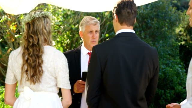 Priest talking to the bride and groom 4K 4k video