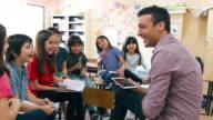istock Primary School Teacher working with students in Classroom 1191508376