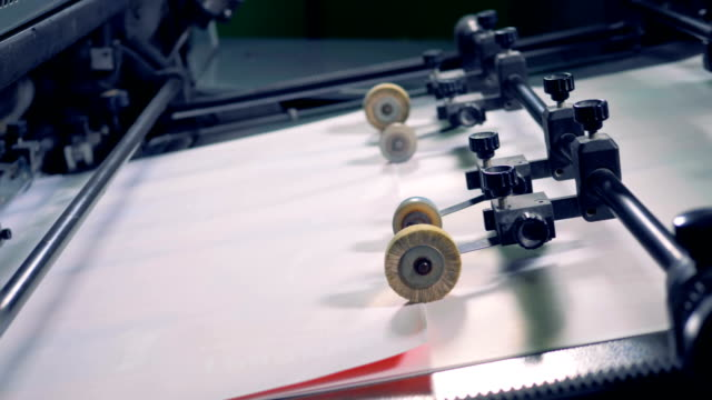 print office machine with rollers, close up. paper recycling. - мембрана клетки стоковые видео и кадры b-roll