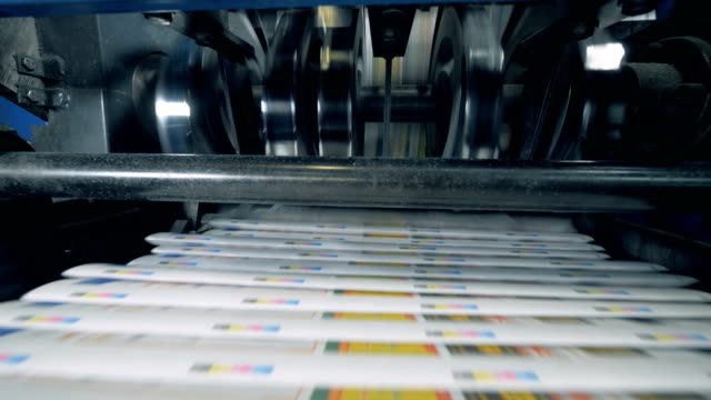 Print office machines moving newspaper on automated line. Print office machines moving newspaper on automated line. 4K printmaking technique stock videos & royalty-free footage