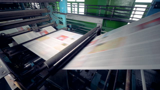 print press typography machine in work. - newspaper paper video stock e b–roll