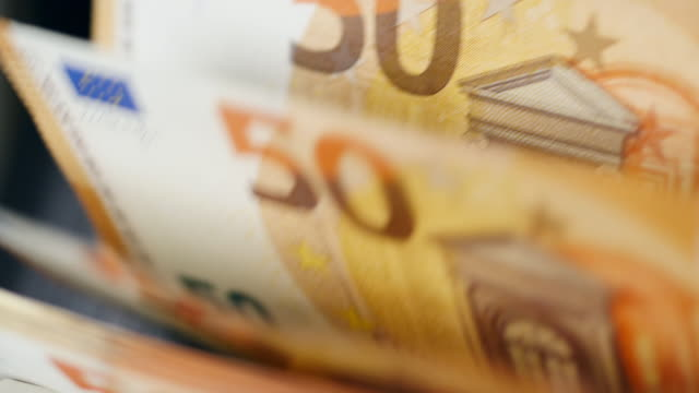 Printed euros checked in automated currency counter. Printed euros checked in automated currency counter. HD european union currency stock videos & royalty-free footage