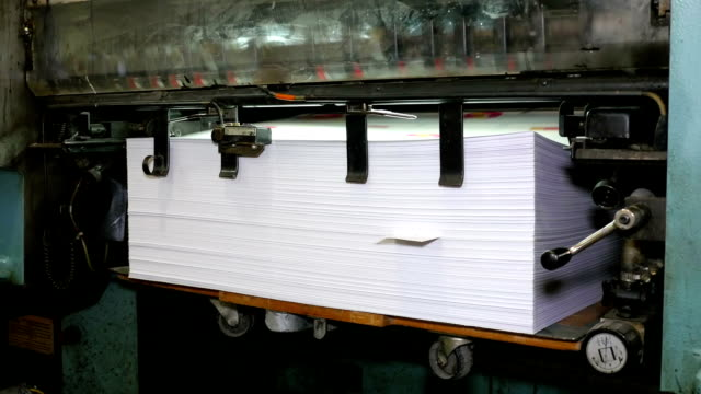 Printed paper is laid in pile video