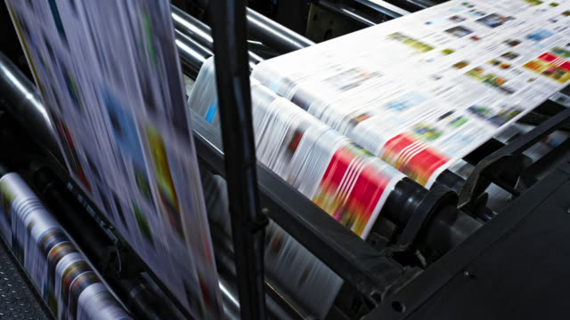 ld printed paper travelling across the rollers of the printing press - newspaper paper video stock e b–roll