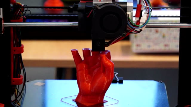 3D printer at work 3D printer print the human hand, 3D printer print the red human hand, Hand Shape Product Printed With 3d Printer printmaking technique stock videos & royalty-free footage