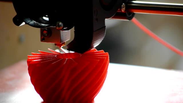 3D printer prints the figure close-up video