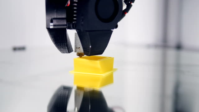 3D printer working. Creation of the three-dimensional model. Close-up. 4K. video