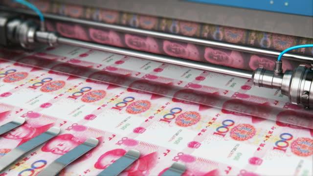stockvideo's en b-roll-footage met 100 chinese yuan geld bankbiljetten afdrukken - economie