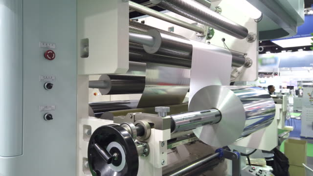 printing and packing machine from plastic roll - aluminum foil stock videos & royalty-free footage