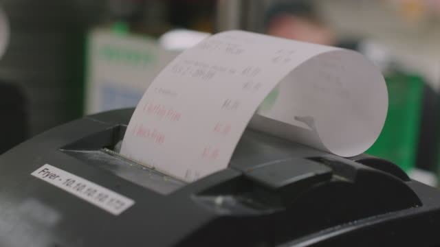 printing order receipt tickets in restaurant kitchen - scontrino fiscale video stock e b–roll