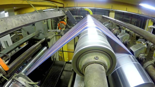 Printing Roll paper newspaper in offset machine. UHD stock video LOOP video