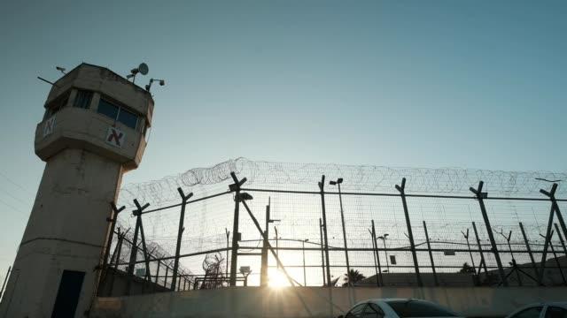 Prison walls at sundown
