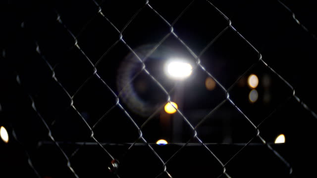 Prison wire fence at night video