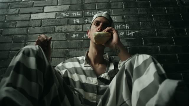 Prisoner eating at prison cell Male prisoner eating at prison cell sentencing stock videos & royalty-free footage