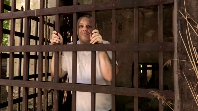 Prisoner in an iron cage video