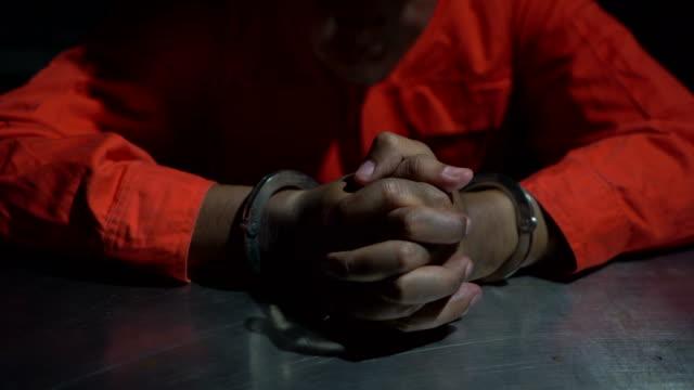 Prisoner Prisoner's hands, Prison Cell / Jail Behind Bars, Criminal prison bars stock videos & royalty-free footage