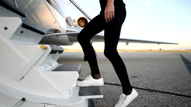 Private airplane - Boarding - female legs moving up stairs