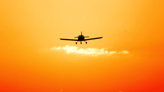 HD: Private Airplane Landing HD1080p: Silhouette of a private airplane landing at sunset. propeller airplane stock videos & royalty-free footage