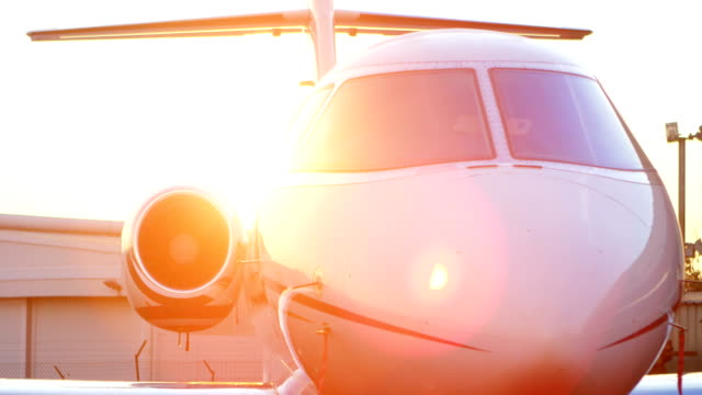 Private jet at terminal 4k Private jet at terminal on a sunny day 4k military private stock videos & royalty-free footage