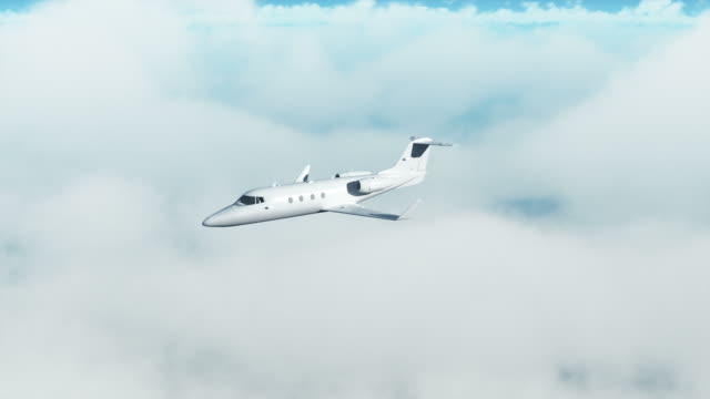 Private jet over clouds Corporate jet flying over clouds. private airplane stock videos & royalty-free footage