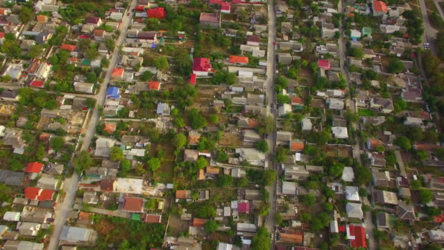 Private Sector With Houses In City District AERIAL VIEW. Panoramic view over the private sector with lots of houses and several streets of a small town district in greenery. military private stock videos & royalty-free footage