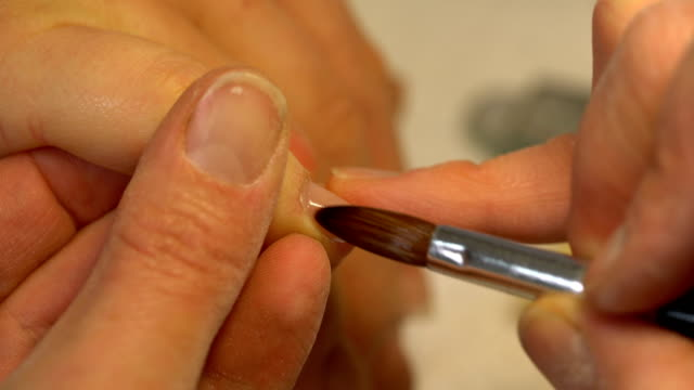 procedure for nail extensions at beautician - nail work tool stock videos & royalty-free footage