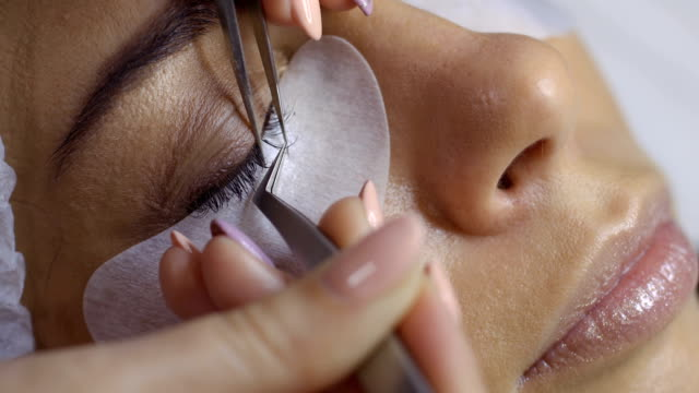 Process of making eyelash extension in beauty salon video