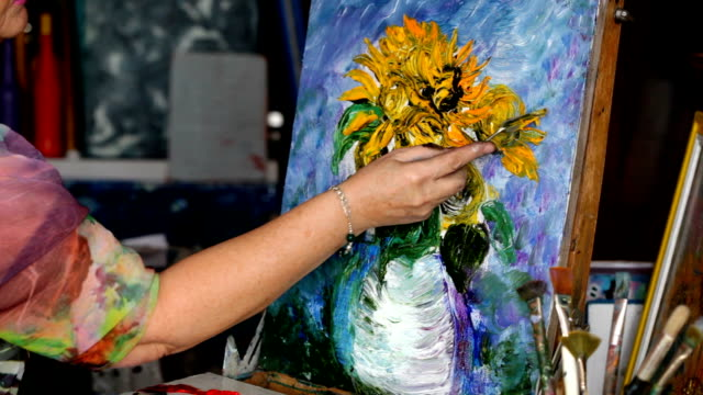 Process of oil painting, artist paints picture on canvas. Sunflowers. video