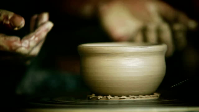 Process of the making of a clay cup in a traditional way on a potter's wheel video