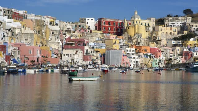procida, naples, italy. panoramic shot of motley colored fishing village on the island. uhd - procida video stock e b–roll
