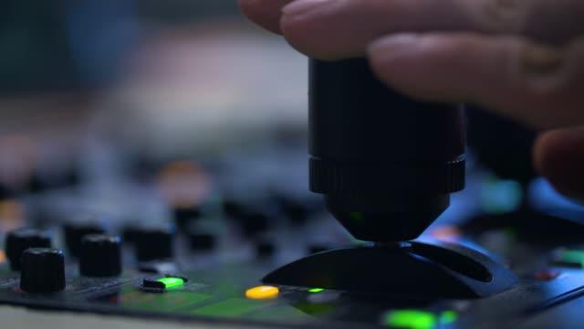 producer working with control desk in studio - studio filmów i materiałów b-roll