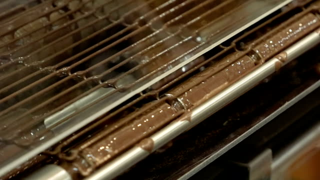 Product conveyor line on a chocolate factory video