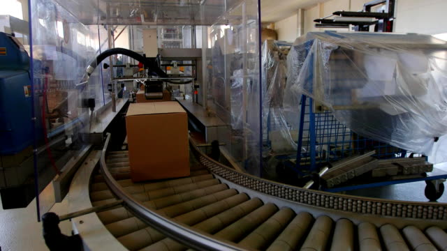 Product packaging line at factory Product packaging line at factory onveyor conveyor belt stock videos & royalty-free footage