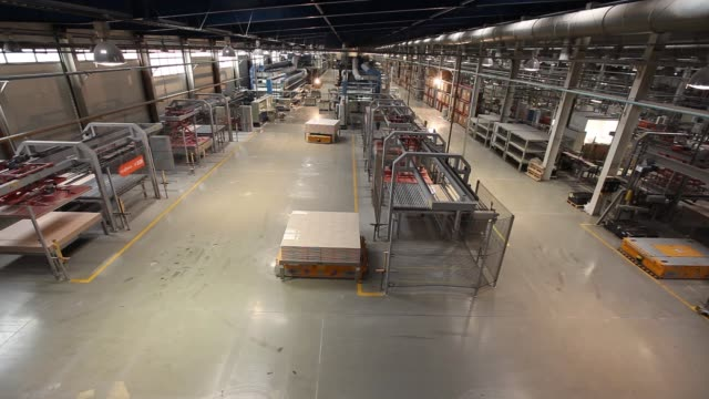 production conveyor, conveyor line, conveyor belt, ceramic tile, kiln firin, production of ceramic tiles, production interior, ceramic tile factory, modern production interior, indoors, inside - metal robot in logistic factory video stock e b–roll