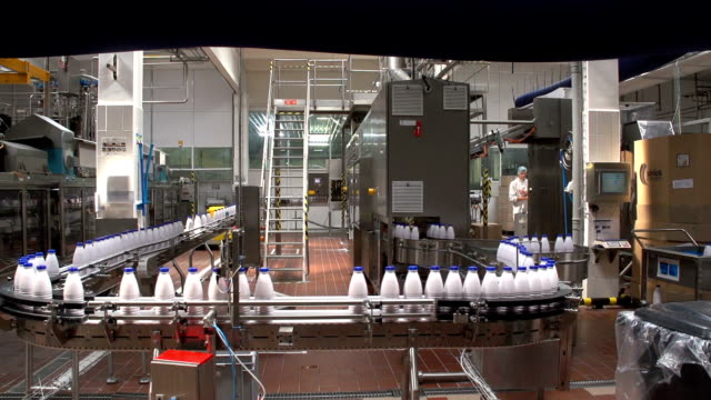 A production line with milk bottles at a modern dairy product plant in Ukraine video