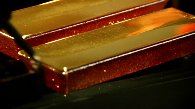 production of gold bars production of gold bars on special production of metals gold bars stock videos & royalty-free footage