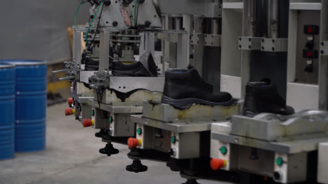 Production of working boots at a shoe factory Production of working boots at a shoe factory - Industry shoe stock videos & royalty-free footage