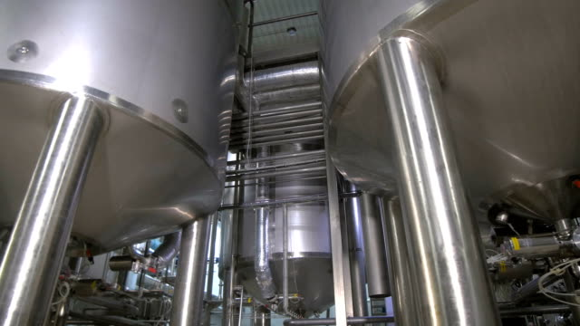 Production tanks, storages at a brewery. Pipline at a brewery factory video