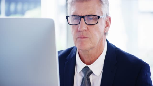 Productivity is of utmost importance to him 4k video footage of a mature businessman working on a computer in an office ceo stock videos & royalty-free footage